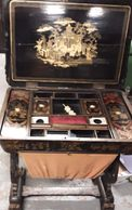 Black lacquerd chinoiserie compartmented sewing box