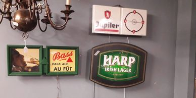 Assortment of illuminated vintage beer signs