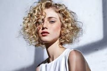 women with curly hair done by a master specialist stylist