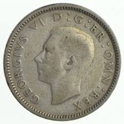 Raleigh Coin Dealers buys all World silver coins like this Great Britian Silver Coin pictured here.