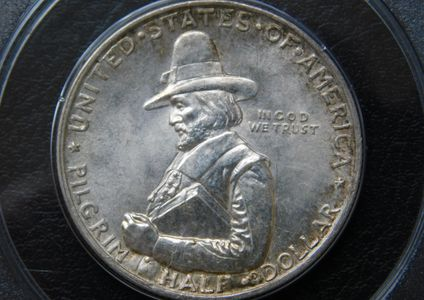 1620-1929 Pilgrim silver commemorative half dollar PCGS MS65 obverse side pilgrim with bible in hand