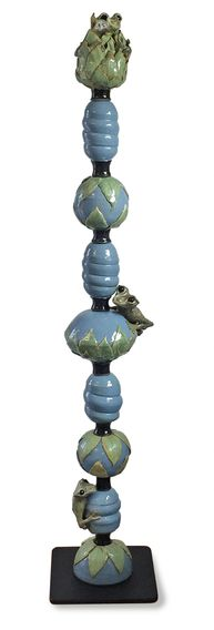 Light blue and soft green pole with 3 large frogs bottom. middle and top