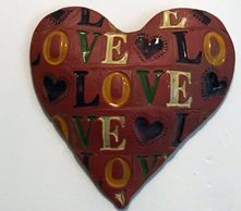 Red heart with LOVE stamped on it