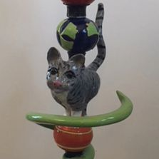 Totem pole with grey cat and green spiral
