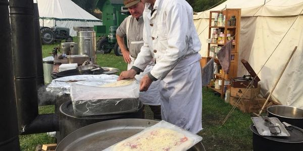 Making and cooking pizzas on a Soyer stove, at a northeast heritage show