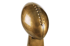 A beautiful bronze-colored football trophy.
