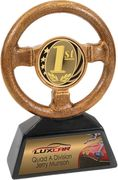 A first place trophy in the shape of a steering wheel with room at the base for a personalized plate