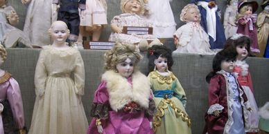 Vintage china head dolls in the Doll House at Har-Ber Village Museum.