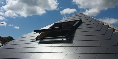 Slate effect fibre cement tiled roof Isle of Wight