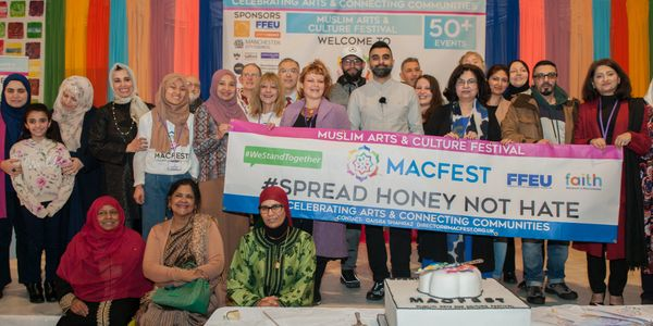 Tez Ilyas and MACFEST volunteers holding Spread Honey Not Hate Banner at MACFEST 2020
