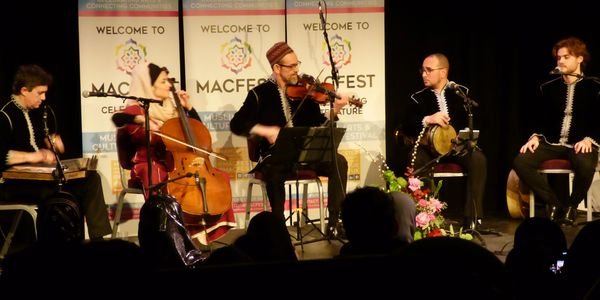 Al Firdaus Ensemble playing music on stage at MACFEST2020