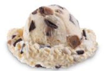 Cookie Dough Pieces and Chocolate Chips blending in Cookie Dough flavored Ice Cream