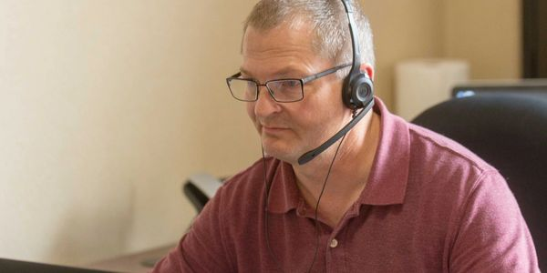 John Christopherson, HID, working with a client on an audiogram at Legacy Hearing Centers.