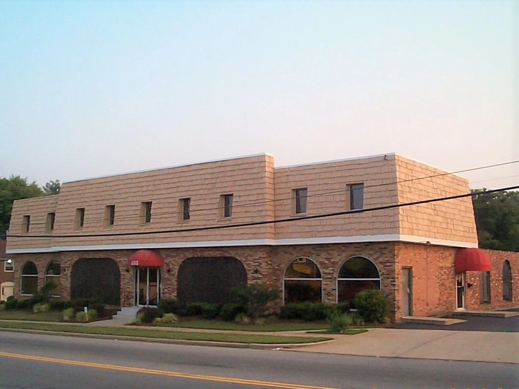 This is our office building.  We are located on the second floor a 6503 Old Branch Avenue, Suite 202