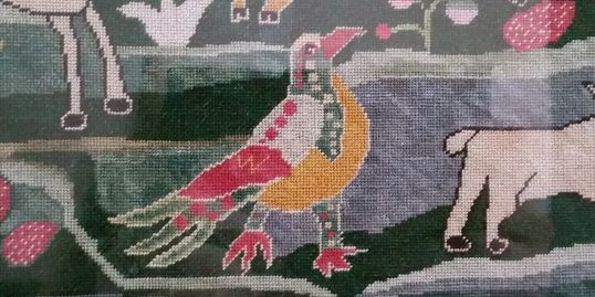 Petit point on a recent reproduction sampler.  Silk on linen.