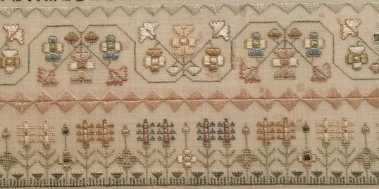 Various embroidery stitches on an early 1800s sampler.  Silk on linen.