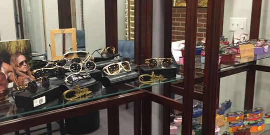A selection of designer eyewear is displayed in the fitting room of Dr. Kofos.