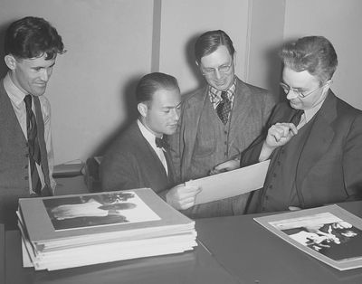 From left to right: John Vachon, Arthur Rothstein, Russell Lee, and Roy Stryker