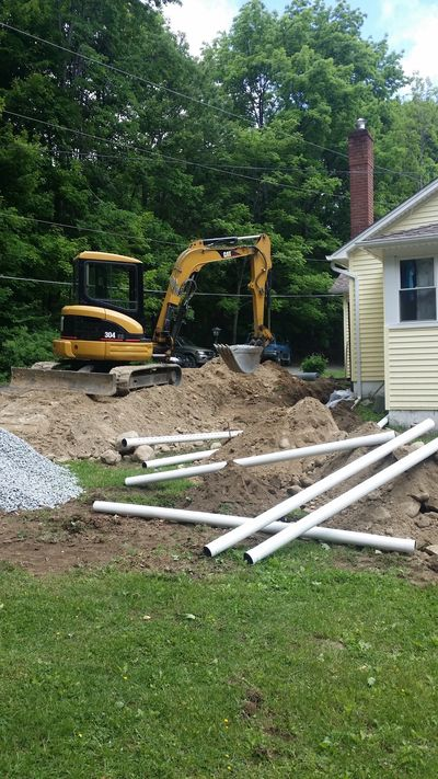 House jacking, foundation wall repair, excavation, footing drains. Kingston, Ulster County, New York