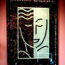 Carved and etched glass sign