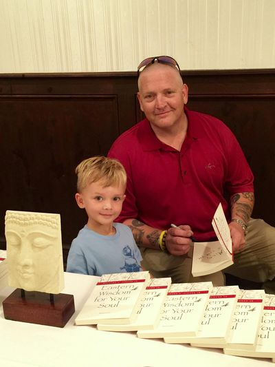 Author Richard Singer with his nephew Milo signing his book Eastern Wisdom Western Soul.