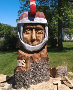 On site Spartans Mascot Chainsaw Carving