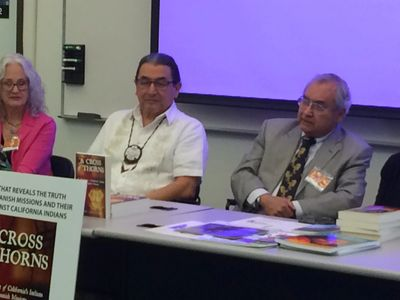 Elias Castillo (right) speaking at a conference at Sacramento State University.