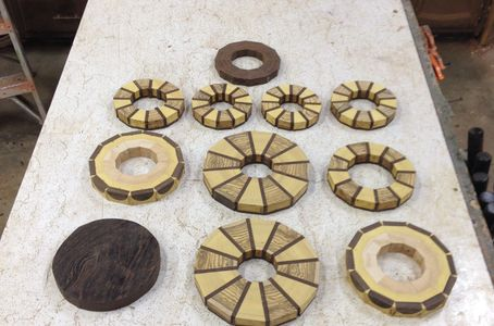 "I use a process called ""Segmented Wood Turning"" I glue small pieces of wood into rings or Blocks."
