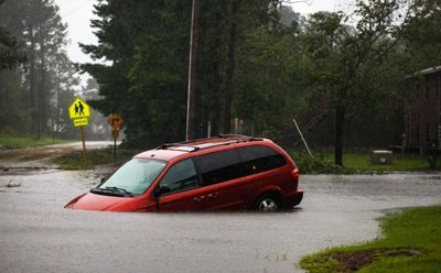 An abandoned van on a flooded road near New Bern on 9/14. LOGAN CYRUS/AFP/Getty Images