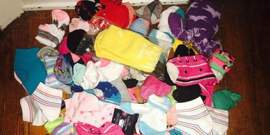 Collecting socks for the Sock-tober National gives back sock drive to benefit the homeless.