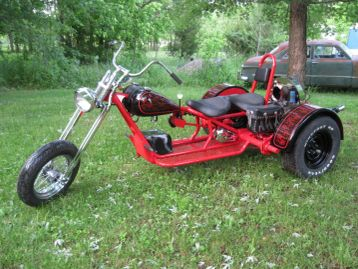 Custom J&S Standard 2 Seat Trike with floorboards, sissy bar, and engine surround kits.