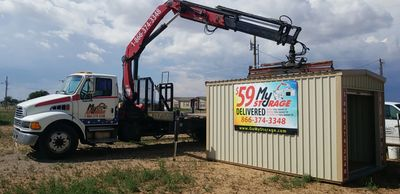 Our boom truck can deliver a storage building to your home or business!