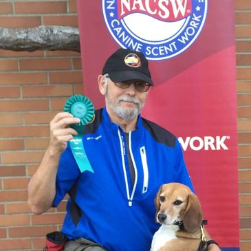 Buddy winning a placement at a NACSW K9 Nose Work Trial.