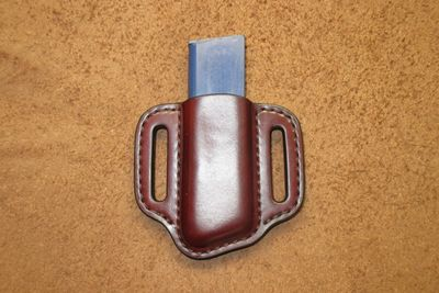 Single pancake magazine pouch for the single stack 1911 pistol available in a variety of colors