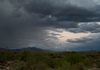 """Moon Rain""-The August Super Moon, rises behind the storm clouds, in the Arizona desert."
