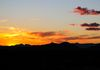 """A Cold Winter Sunset""- A cold and windy sunset over the desert mountains."