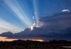 """Stormy Sunset Rays"" - The sun sets behind a thunderstorm and shows-off it's beautiful rays of light, over the desert, in New River, Arizona, USA."