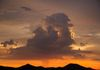 """Giving It All""- A lone storm cell releases all that it has over the desert."