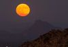 """Harvest Supermoon Rise With Red Mountain""-The rising Harvest Supermoon graces the sky over Scottsdale, Arizona."