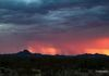 """Red Rain Shafts At Sunset""- Rain shafts from a passing monsoon storm, fall over the southwest valley, in Arizona."