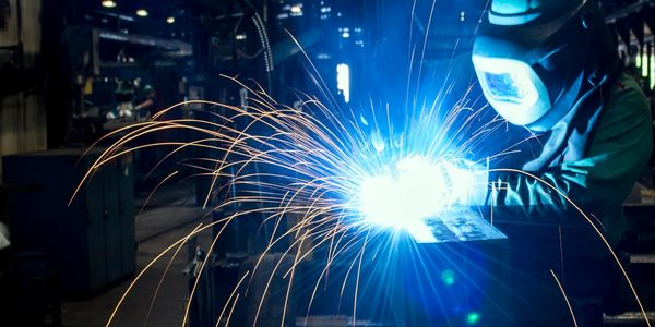 A picture of a welder at American Buildings, located in Eufaula, Alabama.