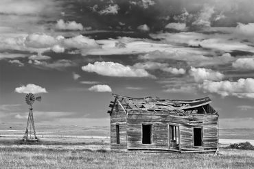 black and white photography,  Gerald Hill photography, Prairie homestead, windmill, Kansas prairie