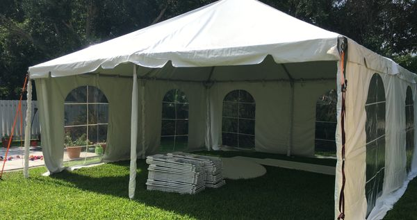 A 20x20 frame party tent with side walls in white