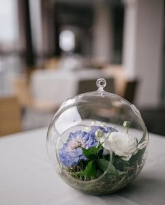 Flowers in bubble glass high top table centerpiece