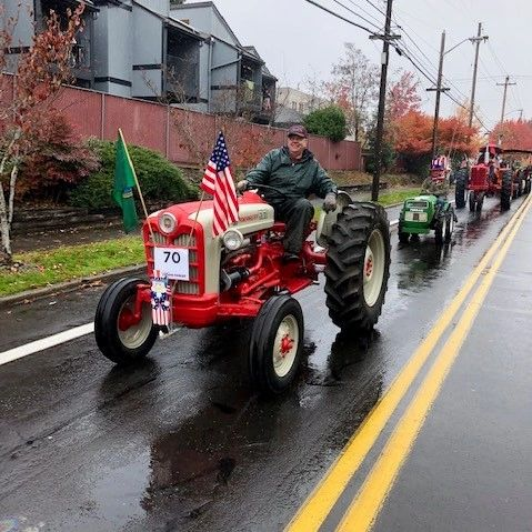Dean leading FVAEA's entry in the Veterans Day Parade, Vancouver USA. Image by Richard Marini.