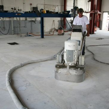 A man doing a concrete coating in MN