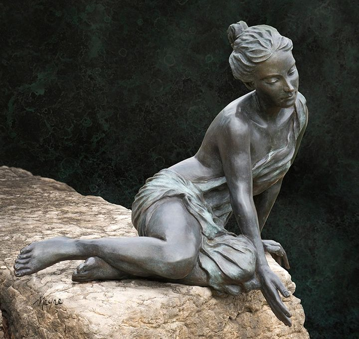 Adamaris is a seated female bronze figure. She is seen testing the water with outstretched fingers.