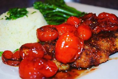 Chicken Cutlets smothered in a Grape Tomato, Balsamic Glaze & Pinot Grigio White Wine Sauce!