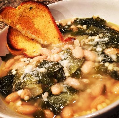 Escarole & Bean soup! This healthy and hearty soup is sure to warm you up on a cold winter's night!