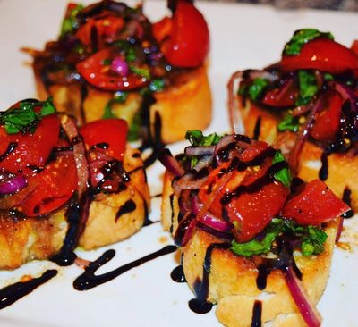 Alexia's beautiful bruschetta made w/vine riped Campari tomatoes, red onion, & lots of fresh basil!
